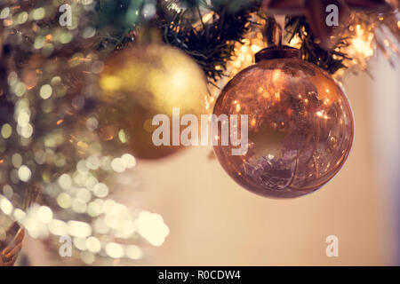 Decorated Christmas tree on blurred, sparkling and fairy background, christmas balls decoration - Stock Photo