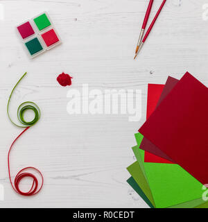 Red and green craft supplies ready for Christmas crafting - Stock Photo