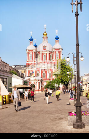 St. Clement's Orthodox Christian Church in Moscow, Russia. People in a small square in front of the church. - Stock Photo