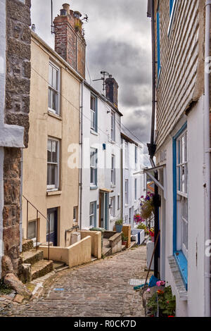 View of a narrow street in the coastal village of St Ives, Cornwall, UK - Stock Photo