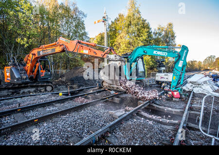 Rail Construction workers building a new platform in station - Stock Photo