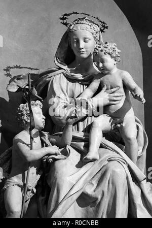 PARMA, ITALY - APRIL 15, 2018: The carved statue of Madonna with the Child and St. John the Baptist in church Chiesa di San Giovanni Evangelista - Stock Photo