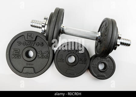 Black steel weights for dumbbells from the brand Domyos. half, one and two kilogram weights. - Stock Photo