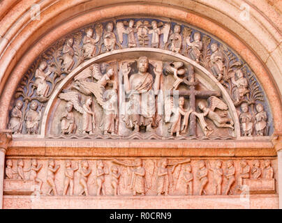 PARMA, ITALY - APRIL 17, 2018: The romanesque relief of Jesus Christ among the angels and twelv apostles on the portal of Baptistery. - Stock Photo