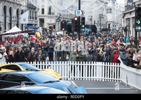 London, UK, 3rd November 2018. People, young and old enjoying the Illinois Route 66 Regent Street Motor Show on Regent Street, completely pedestrianised from Piccadilly Circus to Oxford Circus. On show are vintage, classic and modern cars and motorbikes, mixed with entertainment and activities for young and old. Credit: Joe Kuis/ Alamy Live News. - Stock Photo