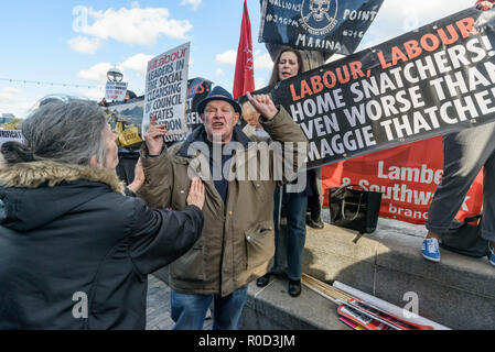 London, UK. 3rd November 2018. Class War supporters came to the 'No Demolitions Without Permission' housing protest at City Hall with banners declaring that Labour Councils were the biggest social cleansers in London and 'Labour, Labour Home Snatchers! Even Worse Than Maggie Thatcher', pointing out that it was largely Labour councils who were demolishing council estates so that developers could replace council houses with large numbers of properties sold at high market prices and a miserably small number of homes at social rent, promoting schemes which cut by thousands the number of council ho - Stock Photo