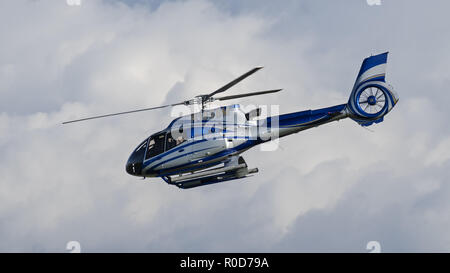 Richmond, British Columbia, Canada. 2nd Nov, 2018. A Eurocopter EC130 T2 helicopter (N1958M), registered to MJB Investments LLC, takes off from Vancouver International Airport. Credit: Bayne Stanley/ZUMA Wire/Alamy Live News - Stock Photo