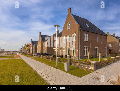 New completed young family houses on a residetial area in Randstad, Netherlands - Stock Photo