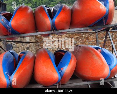 Orange and blue kayaks on a transportation trailer - Stock Photo