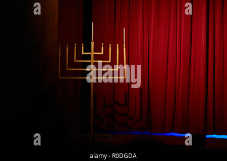 Judaism and jewish faith concept with close up on a menorah with candles for Hanukkah against defocused lights - Stock Photo