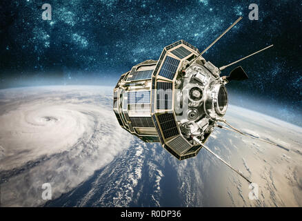 Space satellite monitoring from earth orbit weather from space, hurricane, Typhoon on planet earth. Elements of this image furnished by NASA. - Stock Photo