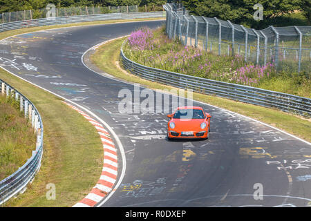 Fast Car on Racing Track in Europe - Stock Photo