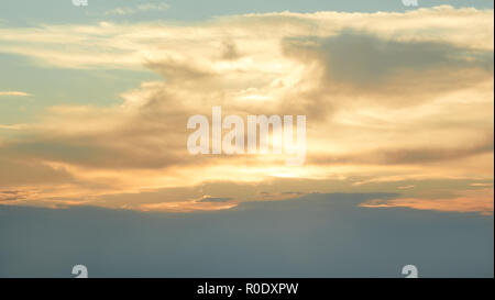 Skyscape in the  evening time. Sun beams punched through the clouds - Stock Photo