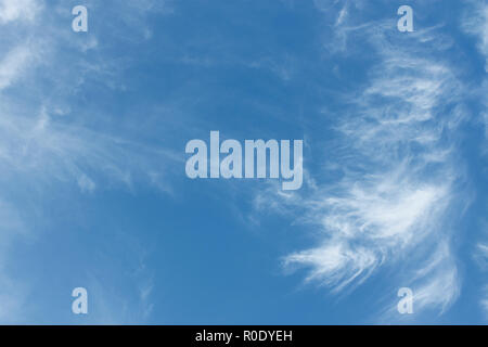 Heaven. Cloudscape of light white clouds and blue sky in warm day - Stock Photo
