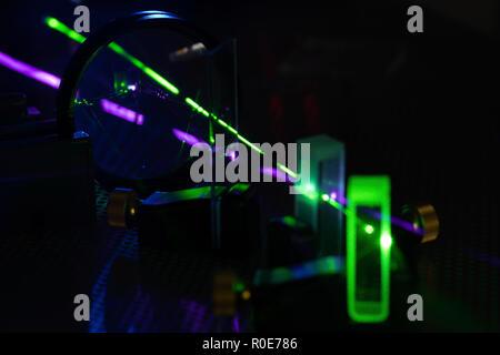 Laser experiment in photonics laboratory. - Stock Photo