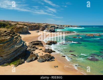 Rock formations on Samoqueira beach at Porto Covo, the Alentejo, Portugal - Stock Photo