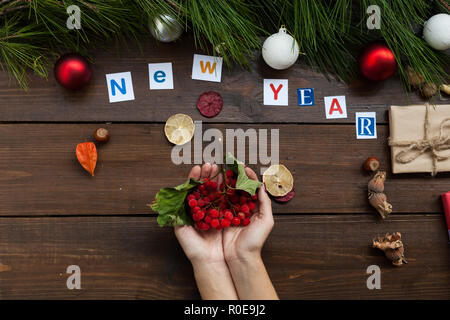 the inscription at the Christmas new year background with Christmas tree and gifts - Stock Photo