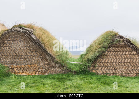 VERMAHLID, ICELAND - AUGUST 2018: traditional Icelandic turf houses houses with grass on roof in Glaumbaer folk heritage museum. - Stock Photo