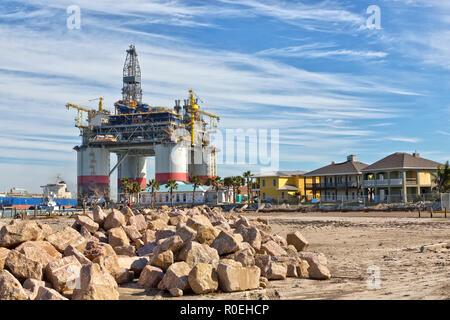 'Big Foot' Chevron's Deep Ocean Platform passing housing, Corpus Christi Ship Channel, Port Aransas. - Stock Photo