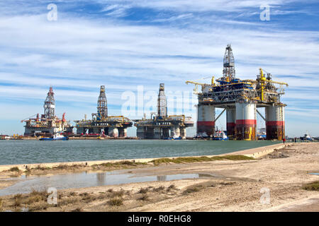 'Big Foot' Chevron's Deep Ocean Platform passing stored Offshore Deep Water Drill Platforms, Port Aransas, Texas. - Stock Photo