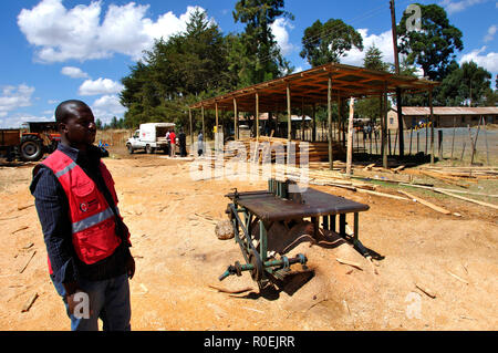 One of 10 Kenya Red Cross timber sites for reconstruction Kenyan farmhouses. - Stock Photo