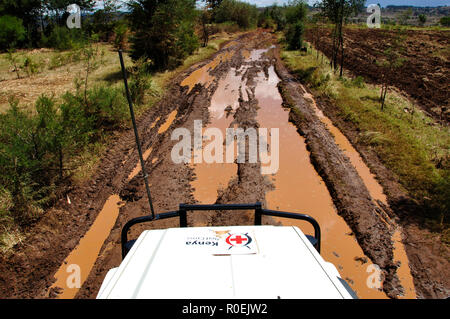 Kenya Red Cross Mission Eldoret: Dirty roads and sometimes bloody work, bad road condition and trouble-shooting everywhere. - Stock Photo