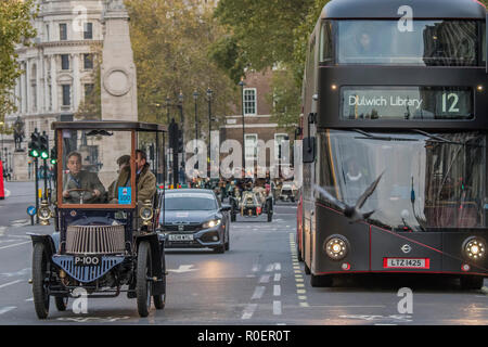 London, UK. 4th November, 2018. Driving down Whitehall - Bonhams London to Brighton Veteran Car Run celebrates the 122nd anniversary of the original Emancipation Run of 1896 which celebrated the passing into law the Locomotives on the Highway Act so raising the speed limit for 'light automobiles' from 4mph to 14mph and abolishing the need for a man to walk in front of all vehicles waving a red flag. The Movember Foundation as our Official Charity Partner. Credit: Guy Bell/Alamy Live News - Stock Photo