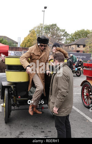 Crawley, West Sussex, UK. 4th November, 2018.   Yasmin LeBon climbs out of ta 1903 Wolsely at the halfway stop at the Honda showroom in Crawley, during the Bonhams London to Brighton Veteran car run Credit: Motofoto/Alamy Live News - Stock Photo