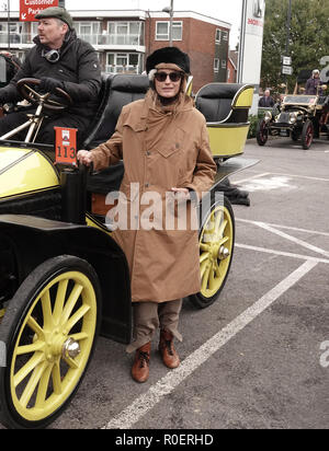Crawley, West Sussex, UK. 4th November, 2018.   Yasmin LeBon (rear seat) in the 1903 Wolsely at the halfway stop at the Honda showroom in Crawley, during the Bonhams London to Brighton Veteran car run Credit: Motofoto/Alamy Live News - Stock Photo