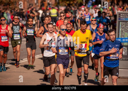 New York, USA. 4th Nov 2018. Runners pass through Harlem in New York near the 22 mile mark near Mount Morris Park on Sunday, November 4, 2018 in the  48th annual TCS New York City Marathon. About 50,000 runners from over 120 countries compete in the race, the world's largest marathon.  (© Richard B. Levine) Credit: Richard Levine/Alamy Live News - Stock Photo