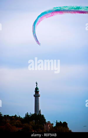 4 11 2018 Trieste, Italy. Acrobatic air performance of Frecce tricolori -- tricolour arrows. - Stock Photo