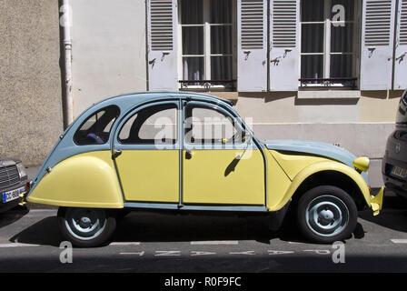 A Citroen 2CV economy car, often nicknamed the 'duck,' parked in the Montparnasse area of Paris, France. - Stock Photo