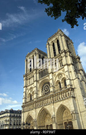 The western facdae of Notre-Dame features two bell towers; the cathedral is one of the finest examples of French Gothic architecture, Paris, France. - Stock Photo