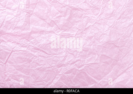 Texture of crumpled pink wrapping paper, closrup. Purple old background - Stock Photo