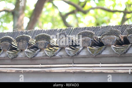 Carving of chinese on the cement wall.  At the Guqin tai (Especially name).  It's chinese musician house. - Stock Photo