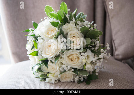 Brides Bouquet waiting to be held by the bride on her Wedding day - Stock Photo