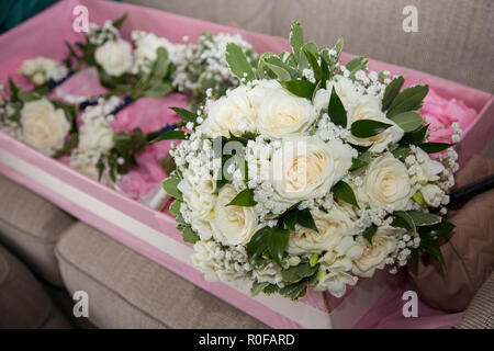 Wedding flowers in a box waiting for the bride on the wedding day - Stock Photo