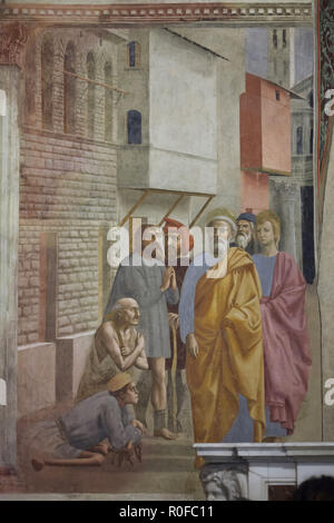 Fresco 'Saint Peter Healing the Sick with His Shadow' by Italian Renaissance painter Masaccio (1424-1425) in the Brancacci Chapel (Cappella Brancacci) in the Church of Santa Maria del Carmine in Florence, Tuscany, Italy. - Stock Photo