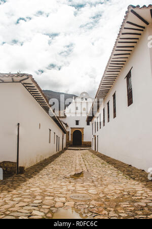 Typical Spanish colonial architecture in Villa de Leyva, an authentic pueblo / small town and popular tourist destination in Boyacá Colombia - Stock Photo