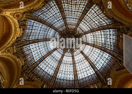 Galeries Lafayette interior in Paris. The architect Georges Chedanne designed the store where a Art Nouveau glass and steel dome - Stock Photo