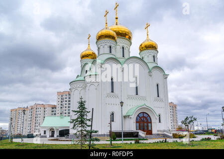 Eastern orthodox crosses on gold domes, cupolas, againts blue sky with clouds. Temple of Stephen of Perm, Moscow, Russia