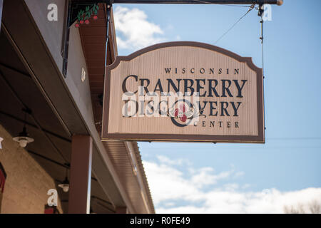 Warrens, Wi - 4 October 2018:  A sign to the Wisconsin cranberry discovery center which as a history of cranberry harvesting - Stock Photo