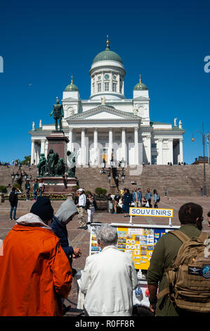 23.06.2018 - Helsinki, Finland, Europe - Toursits stand at a souvenir stall on Senate Square with the Helsinki Cathedral in the backdrop. - Stock Photo