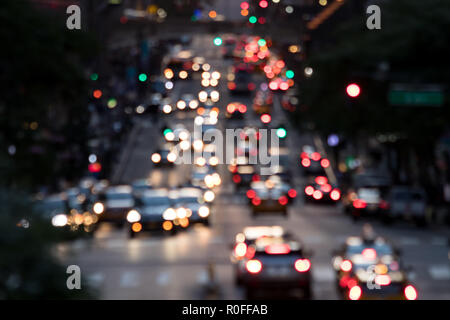 Abstract blurred lights of evening traffic on 42nd Street in Midtown Manhattan New York City NYC - Stock Photo