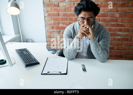 yired Indian office worker is fed up working - Stock Photo