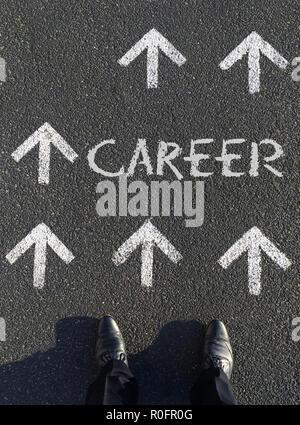 Moving forward: A man choosing his next career steps - Stock Photo