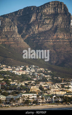 Camps Bay at sunset with background of Twelve Apostle mountains in Cape Town South Africa - Stock Photo