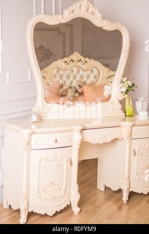 Boudoir table. Details of the interior of the bedroom for girls and make-up, hairstyles with a mirror. Good morning coffee in bed.Boudoir table, dressing table.Romantic design for bedroom. - Stock Photo