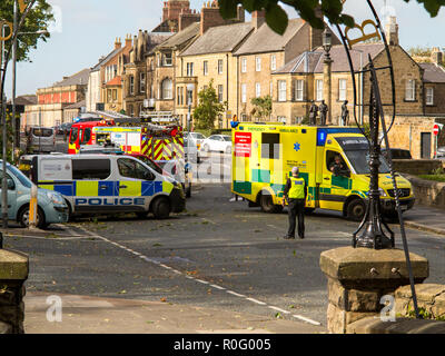 Emergency services fire police and ambulance paramedics attend a road traffic accident  at Alnwick Northumberland England UK