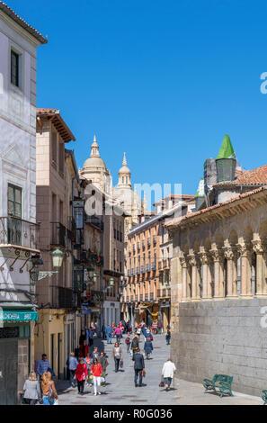 View down Calle Juan Bravo with the Cathedral in the distance, Plaza de San Martin, Segovia, Castilla y Leon, Spain - Stock Photo